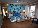 Fish wall with 1 Twin bed and side chair, sheets & pillow case stored in Entertainment center.