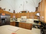 Left side of Kitchen showing Fridge/Freezer, Dish washer, Coffee Pots, etc.