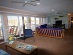 Long View of Family Room,  open Sliders  and enjoy our Balcony.