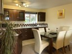Modern and fully equipped kitchen with views up to Blencathra.