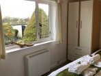 Master bedroom with views down St John's and our beautifully maintained garden.