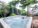 Get out and enjoy the outside with a dip in the hot tub or a swing in the hammock by the fire.