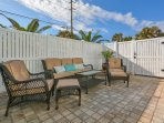 Back patio with plenty of seating for outdoor entertaining.