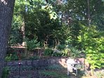 Back garden and entrance to Wooded Area.