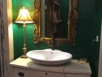 Vessel sink in the attached Emerald bath.
