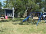 Back Yard - Cubby House and Swing set for the children to play on