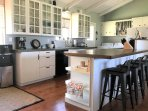 Large open kitchen with breakfast bar