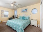 Coastal themed Master bedroom has comfy king size bed