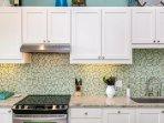Modern kitchen with beautiful tile back splash.