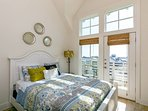 Upstairs guest bedroom with Queen Bed and attached balcony overlooking Lake...