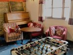 Our Games Room offers a comfortable space to relax in inclement weather.