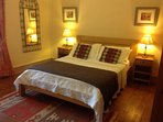 Master bedroom with a king size bed and well furnished.