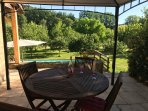 Outdoor alfresco dining overlooking the pool and orchard.
