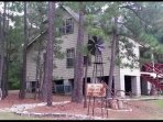 The rustic cabin in the middle of the 10 acres wood The welcoming front porch offers a wonderful opp