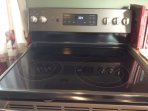 New GE Convection bake electric ceramic cook top with 4 burners and a warming zone.