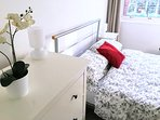 Bedroom 1 with double bed, drawers, double fitted mirrored wardrobe