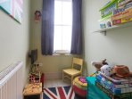 Kids playroom with dressing up box and tv plus lots of books/ games /toys