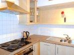Fully equipped: oven, m'wave, coffee machine, fridge, freezer, dwasher, washer-dryer, kitchenware