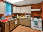 Full kitchen with all amenities, microwave, gas oven/stove, fridge, coffee maker, toaster everything