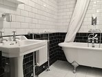 Victorian Style Bathroom. Slipper bath, Pedestal Handwash Basin, Towel Rail and WC.