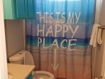 Upstairs bathroom.  Come find your happy place at the beach.