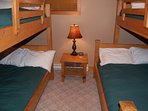 The fourth bedroom features two bunk beds.