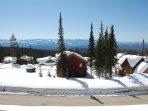 This unit has a private balcony with a propane BBQ and a beautiful view of the Monashee Mountains.