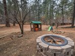 Watch the kids play while you warm up by the fire pit!