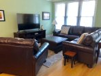 Plenty of seating with the new living room furniture.