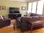 Enjoy the new living room furniture and large deck in the living area.