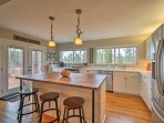 Look out to stunning wooded views while cooking!