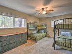 With 2 twin-over-twin bunk beds, this room sleeps 4.