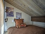 Climb up the stairs to access the loft with a full bed.