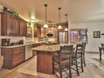 Fully Equipped Kitchen with New Stainless Steel Appliances, Granite Counters and Island Seating