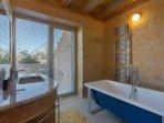 En-suite bathroom featuring a bath tub