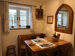 Cottage kitchen seats 5. View through conservatory to garden. Treats in fruit bowl. Photo Jan 2018