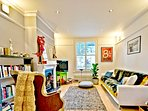 Bright open plan living room - Sky TV & extensive book