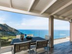 Outdoor veranda with a dining table which also leads you to the pool area.
