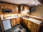 Prepare meals in the small kitchenette and enjoy them at the dining table or breakfast bar.