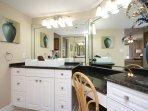 Completely remodeled bathroom w/ modern vessel sinks & vanity.