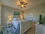 This inviting bedroom offers a comfy queen bed.