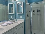 Rinse off in this bathroom with double vanities and walk-in shower.