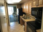 Full Kitchen With Oven, Microwave and Fridge
