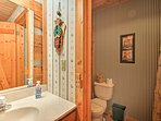 The one full bathroom is stocked with fresh towels for guest's comfort.