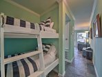 This twin-over-twin bunk bed in the hallway is great for kids!