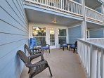 This corner unit features an expansive balcony with ocean views!