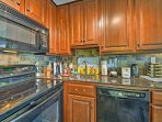 The kitchen features granite countertops and all of the necessary cookware.