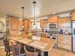 Stainless steel appliances and ample granite countertops make home-cooking a breeze.