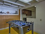 The downstairs game room has a foosball table and separate nook with a flat-screen cable TV.