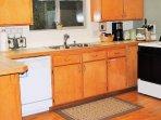 kitchen area with dishwasher, stove, fridge, and microwave